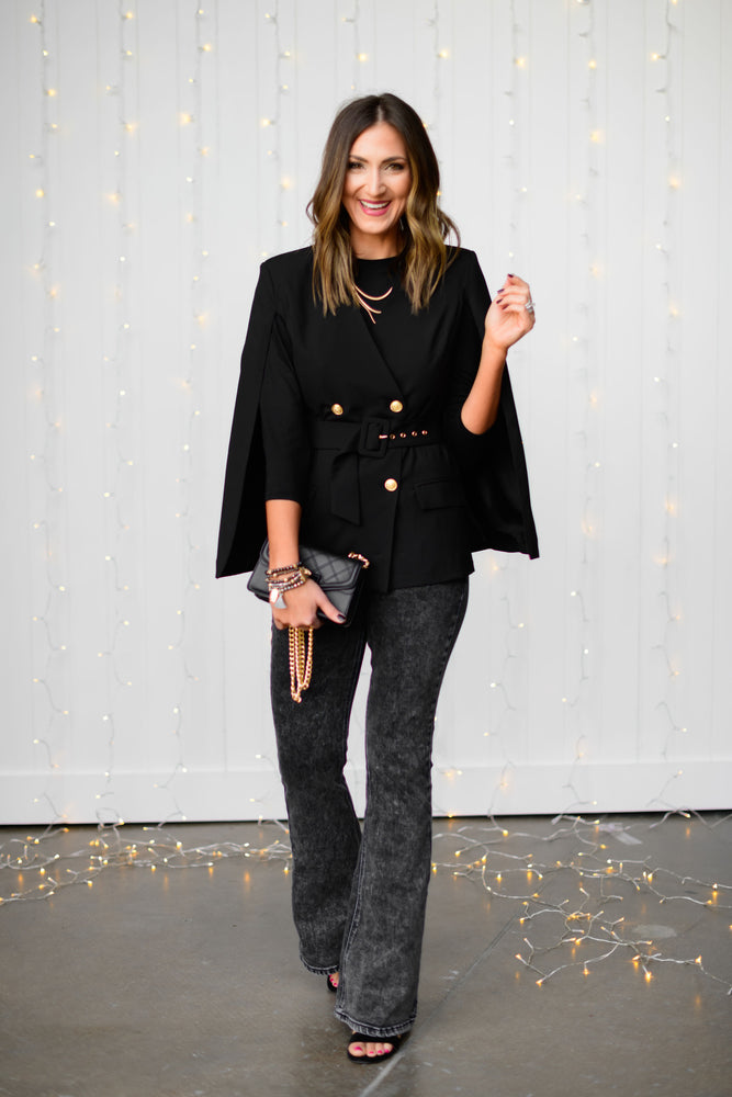 black-double-breasted-belted-cape-with-gold-buttons-black-quilted-crossbody-purse-black-flare-jeans-glass-beaded-bracelets-holiday-launch-holiday-party-outfits-holiday-chic-black-crossbody-purse-shop-style-your-senses-by-mallory-fitzsimmons