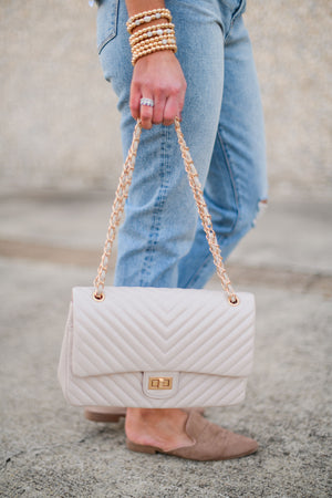 beige diagonal quilted bag with chain, affordable accessories, trendy handbags, shop style your senses by Mallory Fitzsimmons