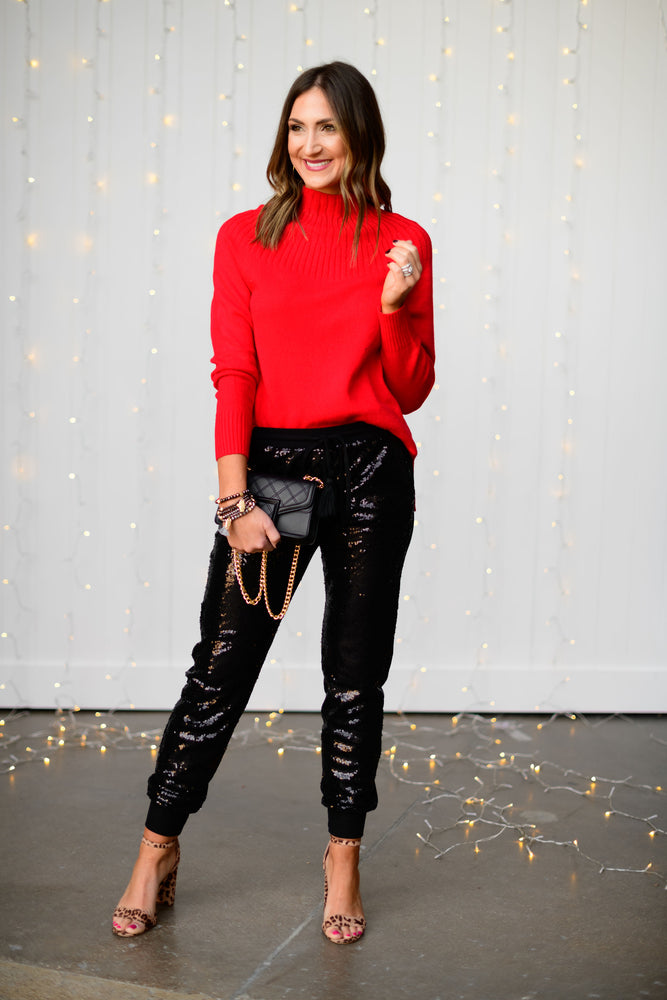 Black-sequin-joggers-holiday-launch-holiday-party-outfits-holiday-sequins-red-mock-neck-sweater-black-and-gold-crossbody-purse-glass-beaded-bracelet-shop-style-your-senses-by-mallory-fitzsimmons