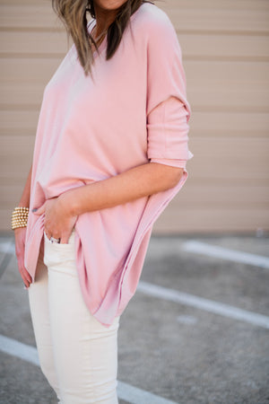 Mauve v neck poncho w/ fitted sleeves, beige distressed skinnies, gold bracelets, evil eye necklace, fresh star, January collection, spring outfits, shop style your senses by mallory fitzsimmons