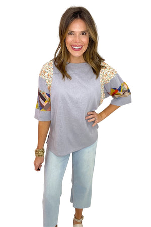 light grey short sleeve top with mixed print panels, wide leg cropped jeans, spring tops, shop style your senses by mallory fitzsimmons
