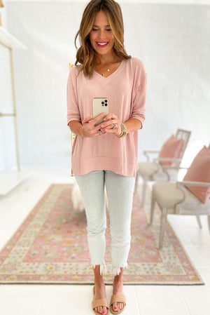 dusty pink oversized v neck top with side slits, acid wash skinny jeans, spring tops, affordable style, shop style your senses by mallory fitzsimmons
