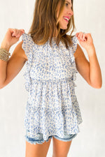 blue and white watercolor flutter top with open back, distressed denim shorts, spring tops, fashion forward, shop style your senses by mallory fitzsimmons