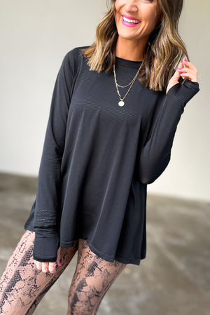 black long sleeve ribbed top with cut out back, affordable athleisure, fitness fashion, shop style your senses by mallory fitzsimmons