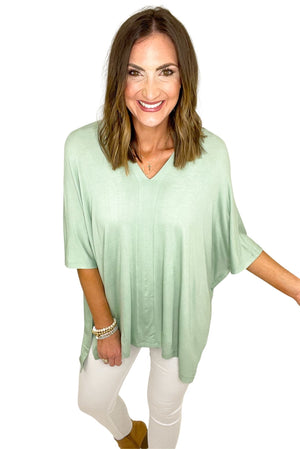 sage lightweight v neck poncho, white skinny jeans, spring tops, shop style your senses by mallory Fitzsimmons