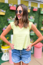 light yellow flutter cap sleeve top, button front denim shorts, spring tops, colorful trends, shop style your senses by mallory fitzsimmons