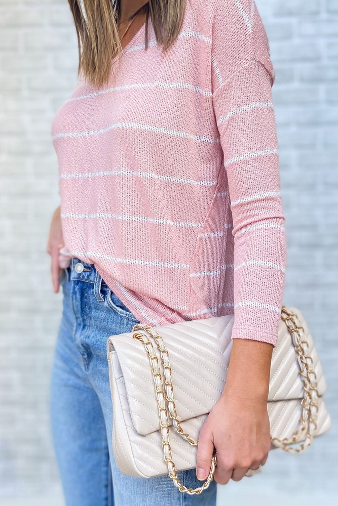 dusty pink hack knit stripe top, medium washed distressed mom jeans, ivory purse w/ gold chain, fresh start, January collection, spring outfits, shop style your senses by Mallory Fitzsimmons