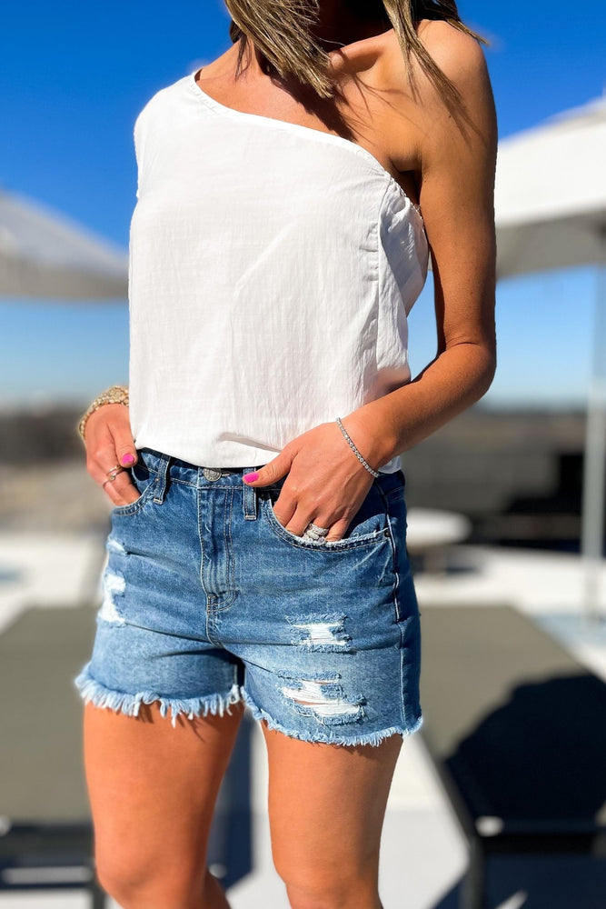 medium wash distressed denim shorts with frayed hem, spring break collection, fun in the sun, beach attire, shop style your senses by mallory fitzsimmons