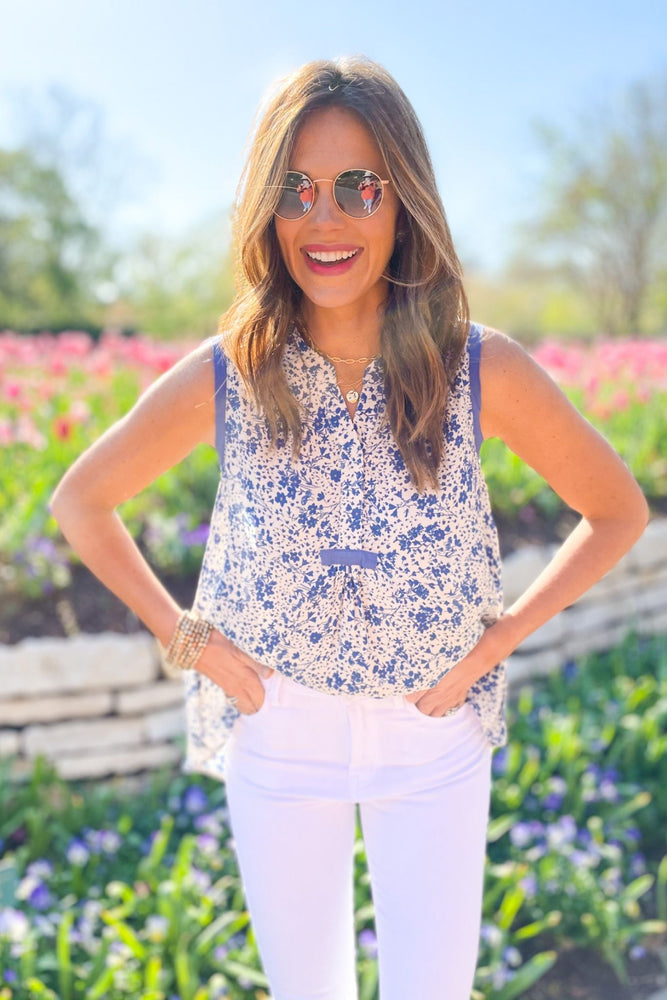 blue floral sleeveless high low top, abloom collection, white skinny jeans, spring outfit inspiration, fresh fashion, shop style your senses by mallory fitzsimmons