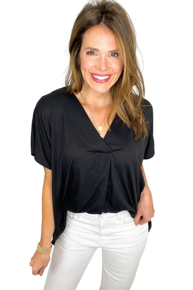 black knit short sleeve top with front placket, spring tops, white skinny jeans, shop style your senses by mallory fitzsimmons