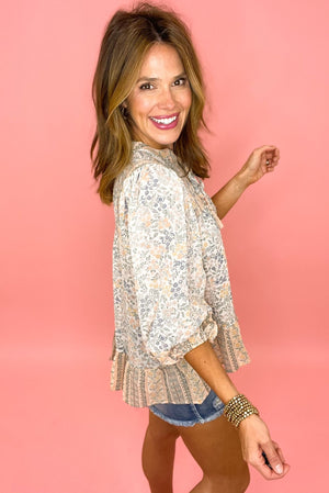 Load image into Gallery viewer, dusty floral long sleeve top with neck tie, distressed denim shorts, boho chic, trendy outfits, shop style your senses by mallory fitzsimmons