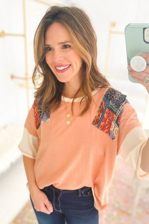 Load image into Gallery viewer, terra cotta top with colorful print sleeves, skinny jeans, spring tops, shop style your senses by mallory fitzsimmons