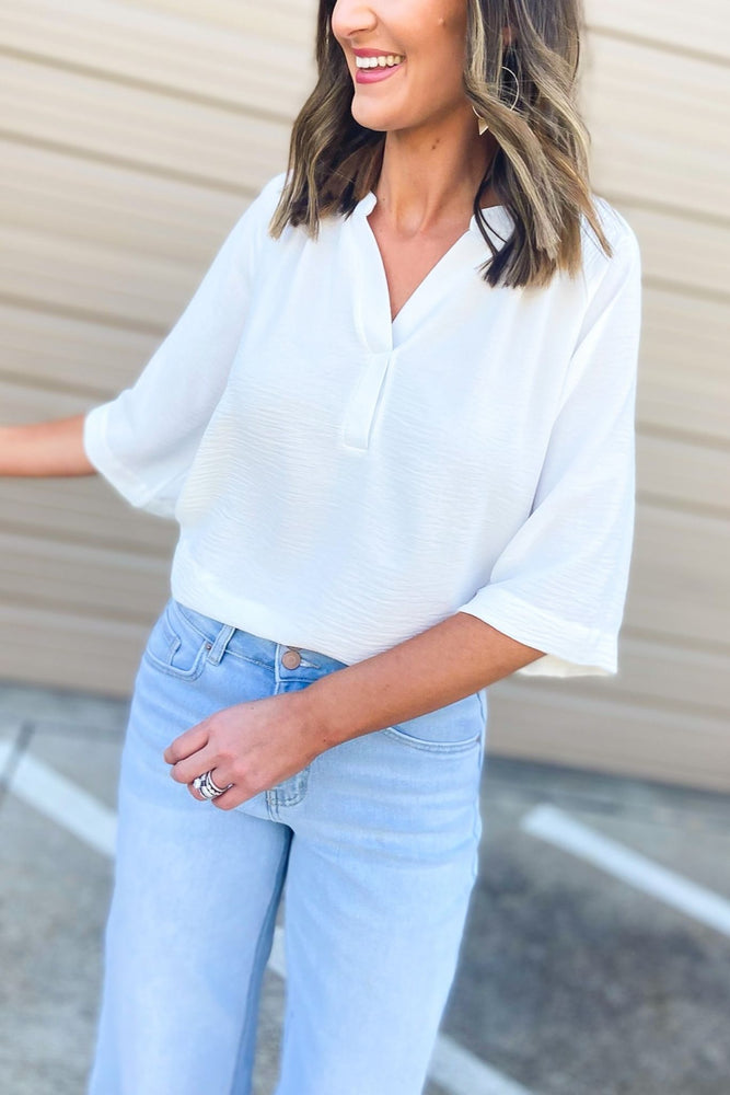 white textured short sleeve v neck top, dreaming of spring, February collection, spring outfits, new arrivals, affordable style, shop style your senses by mallory fitzsimmons