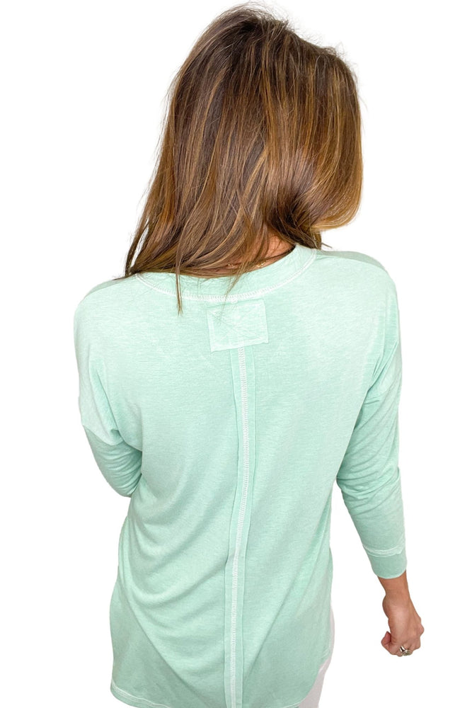 Load image into Gallery viewer, green v neck long sleeve top with split hem, white skinny jeans, spring tops, affordable style, shop style your senses by mallory fitzsimmons