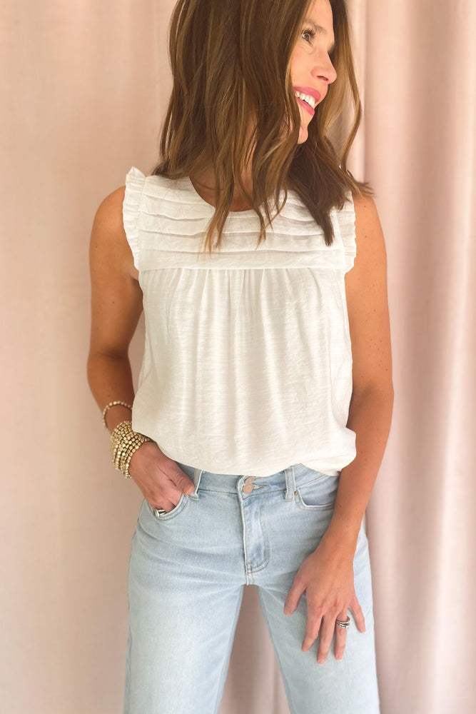 off white pleated bib mini ruffle sleeve top, light wash wide leg cropped jeans, spring tops, shop style your senses by mallory fitzsimmons