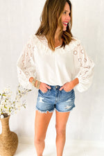 white eyelet balloon sleeve top, distressed denim shorts, spring outfits, shop style your senses by mallory fitzsimmons