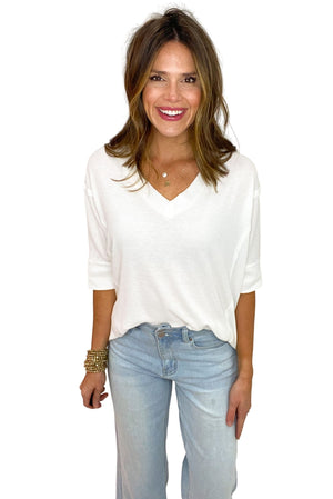 white oversized v neck top with side slits, wide leg cropped jeans, spring basics, shop style your senses by mallory fitzsimmons
