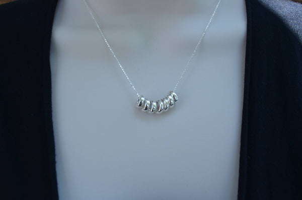 7 Rings of Luck Sterling Silver Necklace
