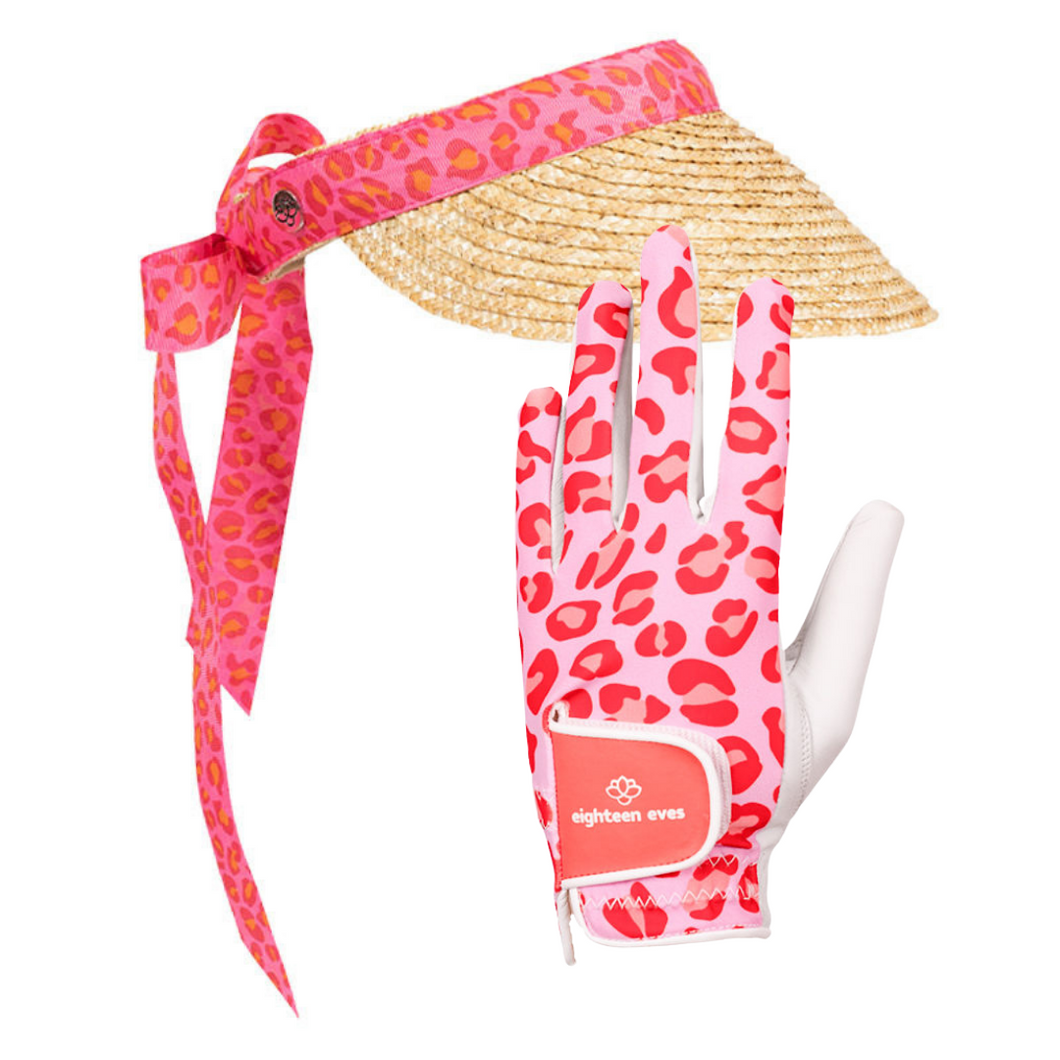 Women's golf visor with straw brim, pink leopard print band that ties into a bow at the back with matching women's golf glove in leopard pink print and white leather palm