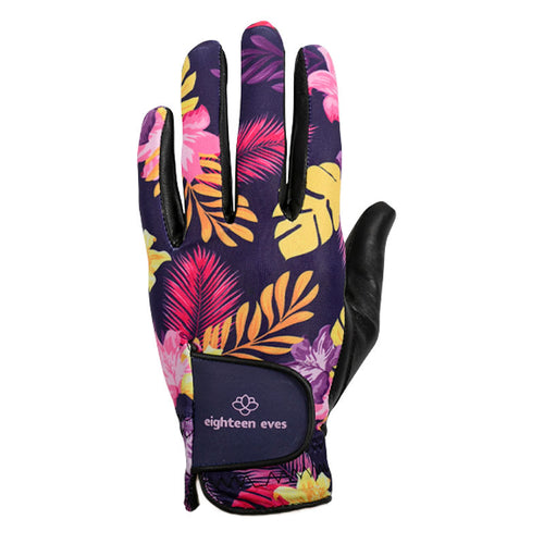 Women's golf glove with pink hibiscus and flower, yellow fern leaf pattern on purple background, black leather palm and purple Velcro tab.