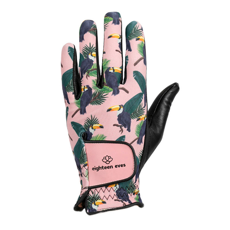 Women's golf glove with tucan print on pink background, black leather palm and pink Velcro tab.