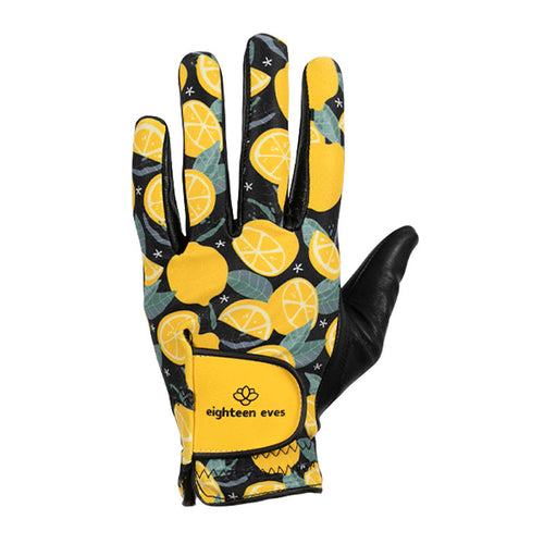 Women's golf glove with lemon print on black, black leather palm and yellow velcro tab.