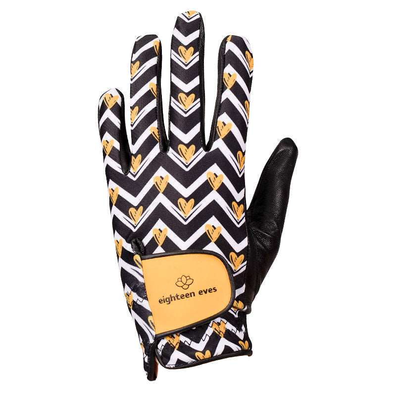 Black and white zig zag with yellow hearts print on women's black leather golf glove. Available in left hand.
