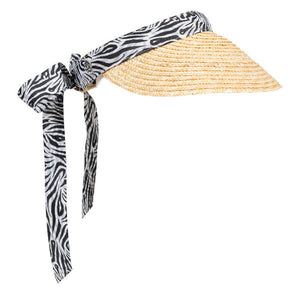 Women's golf visor with straw brim, black and white Zebra print band that ties into a bow at the back