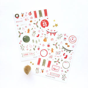 Vinyl sticker sheet set with festive christmas designs in red, green and gold.