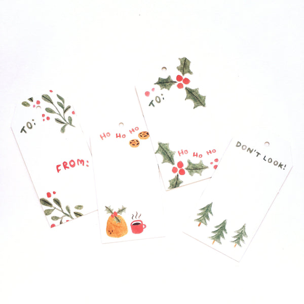 Set of four Christmas gift tags decorated with festive illustrations such as mince pies, mistletoe and holly.