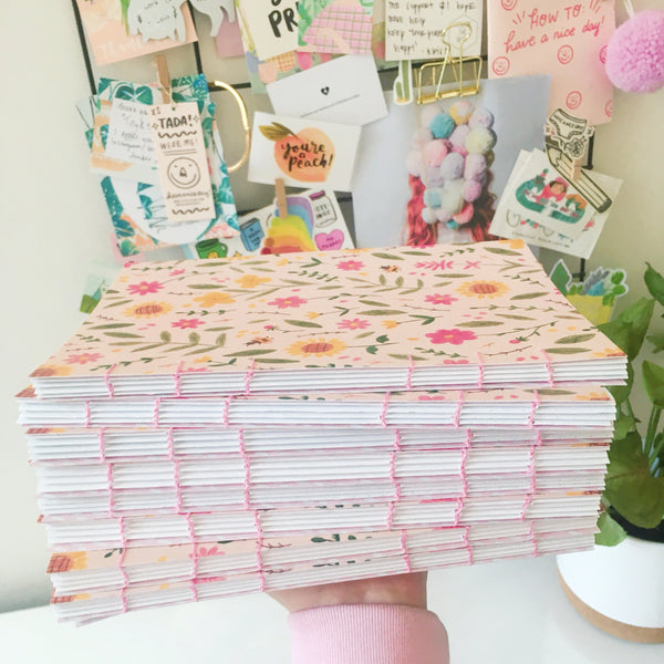Stack of colourful handmade journals.