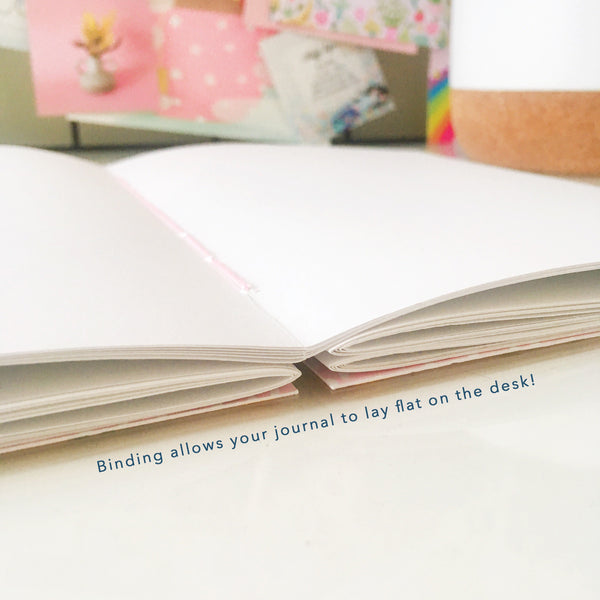 The journal's binding allows it to open flat on your desk for ease of writing or drawing.