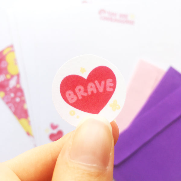 Envelope seal stickers feature a small heart with the word BRAVE to seal your envelopes closed and keep your letters safe!