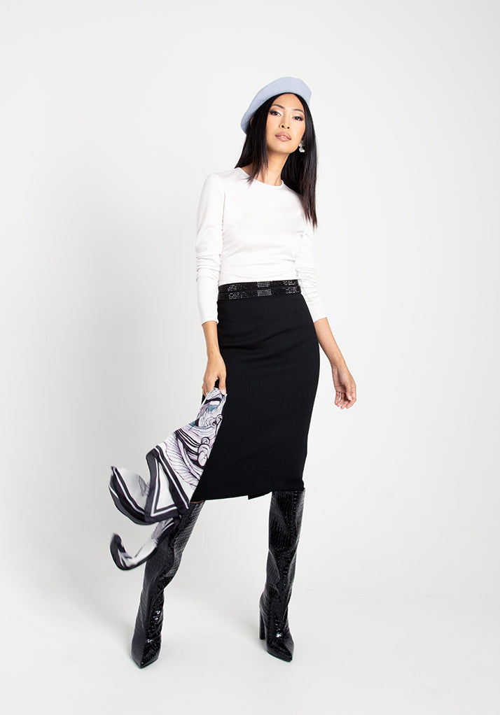 Woman wearing pencil skirt and white blouse