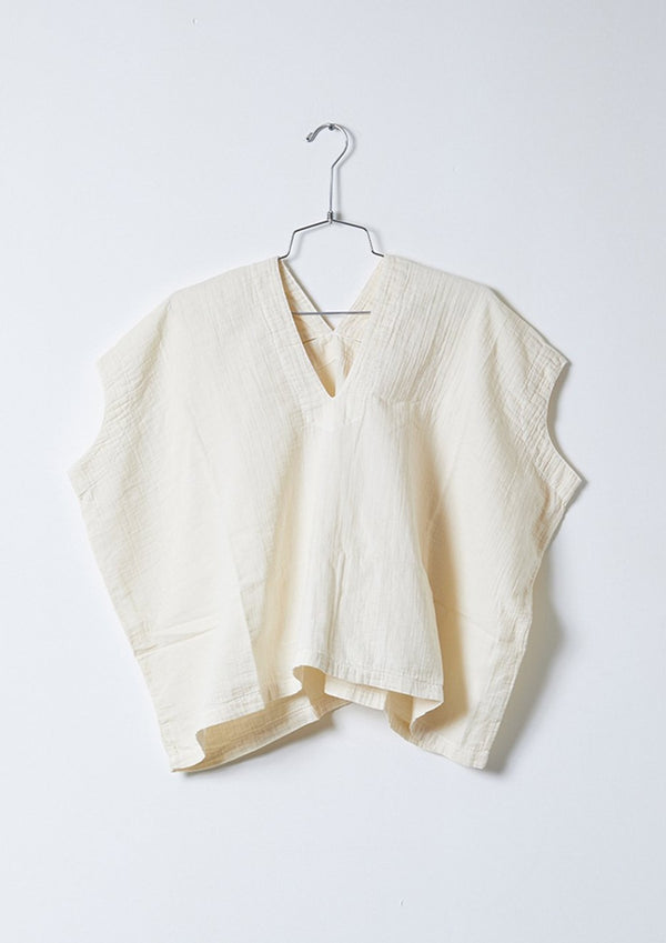 Reversible boxy, sleeveless top with seaming details. Crafted in a beautiful Japanese cotton gauze with a natural crinkle texture.   Relaxed, boxy fit 100% cotton Made in USA Machine wash gentle cycle / hand wash / tumble dry low