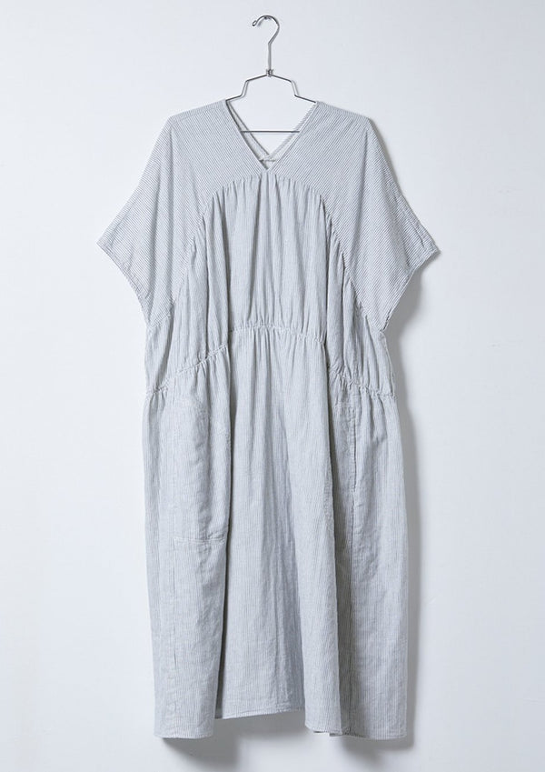 Tiered pullover maxi dress with v-neckline and side pockets. Crafted in a beautiful striped Japanese double layered cotton gauze with a natural crinkle texture.   The dress is not see-thru but does have a small bit of sheerness due to the nature of the gauze fabric and the light color.