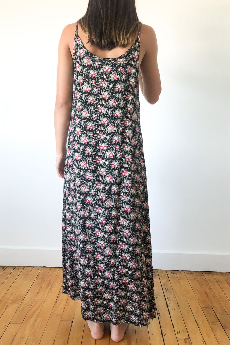 Vintage maxi slip dress in an allover floral print on black ground with scoop neckline.