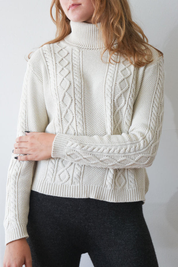 Vintage silk and cotton blend cable knit turtleneck sweater in ivory.