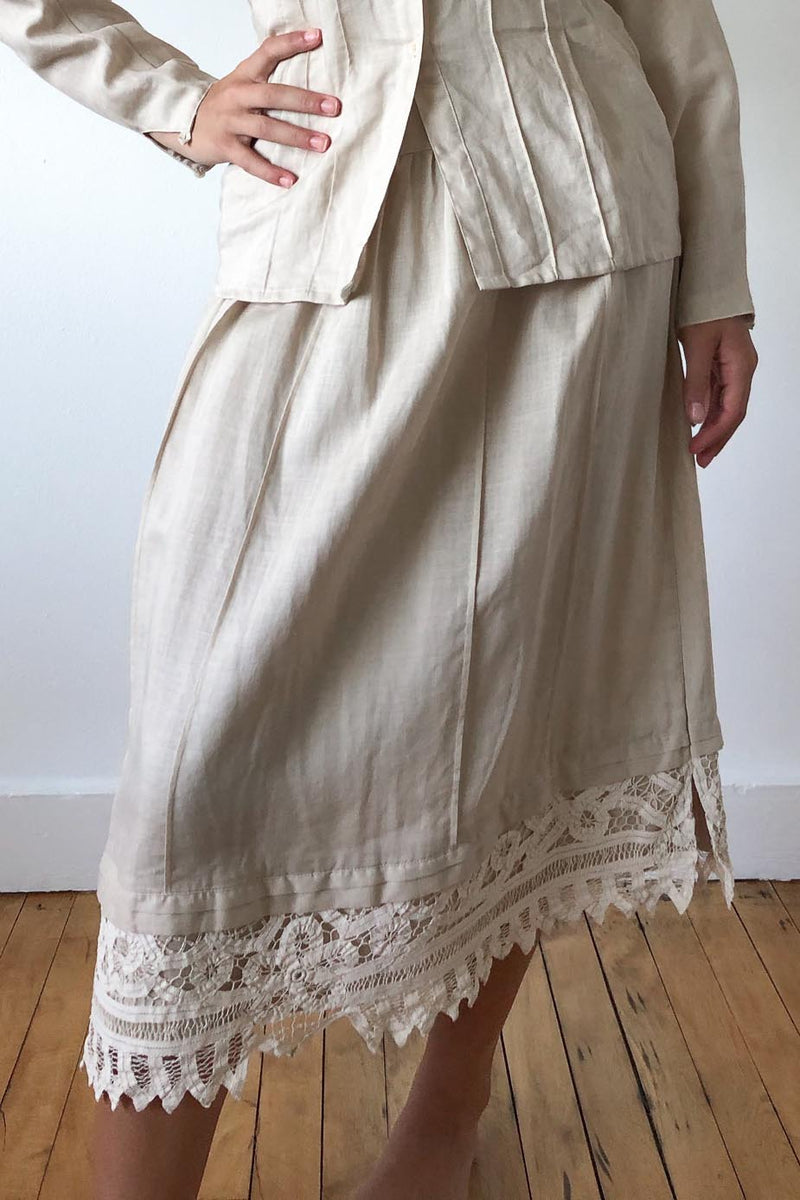 Vintage midi skirt in natural color featuring lace detail at hem.