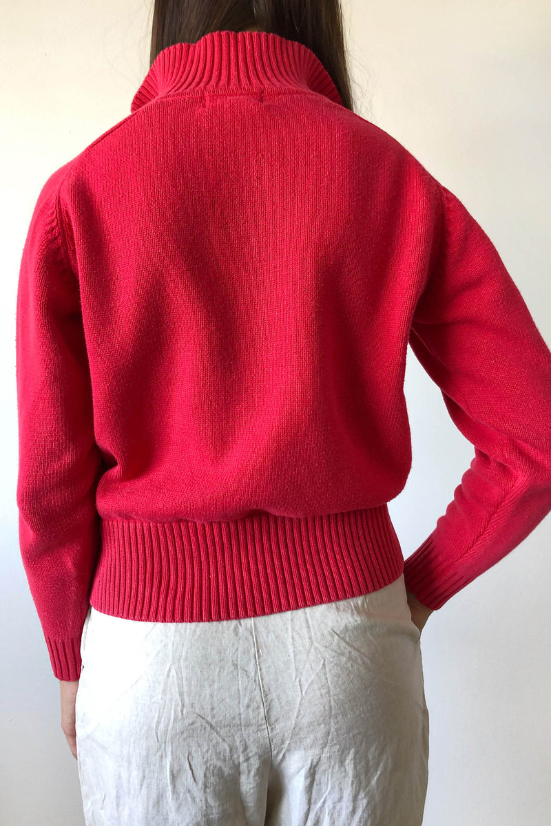 Long sleeved cotton pullover sweater in washed red.