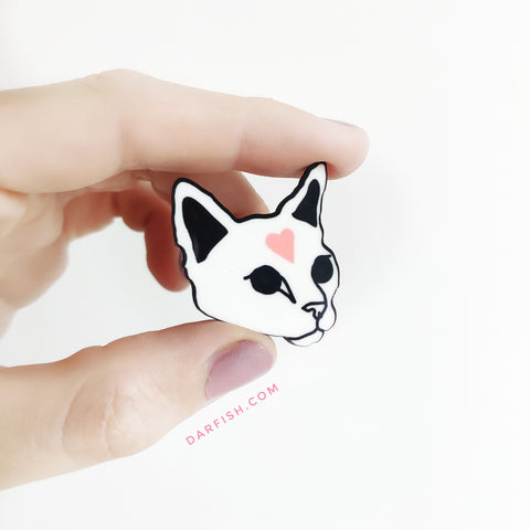 Cat with heart pin