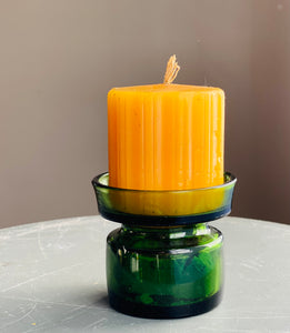 Dansk Design Candleholder with Original Yellow Candle Designed by Jens Harald Quistgaard for Dansk Design in the 1960s.