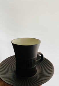 Jens Harald Quistgaard's 'Fluted Flamestone' teacup and saucer.