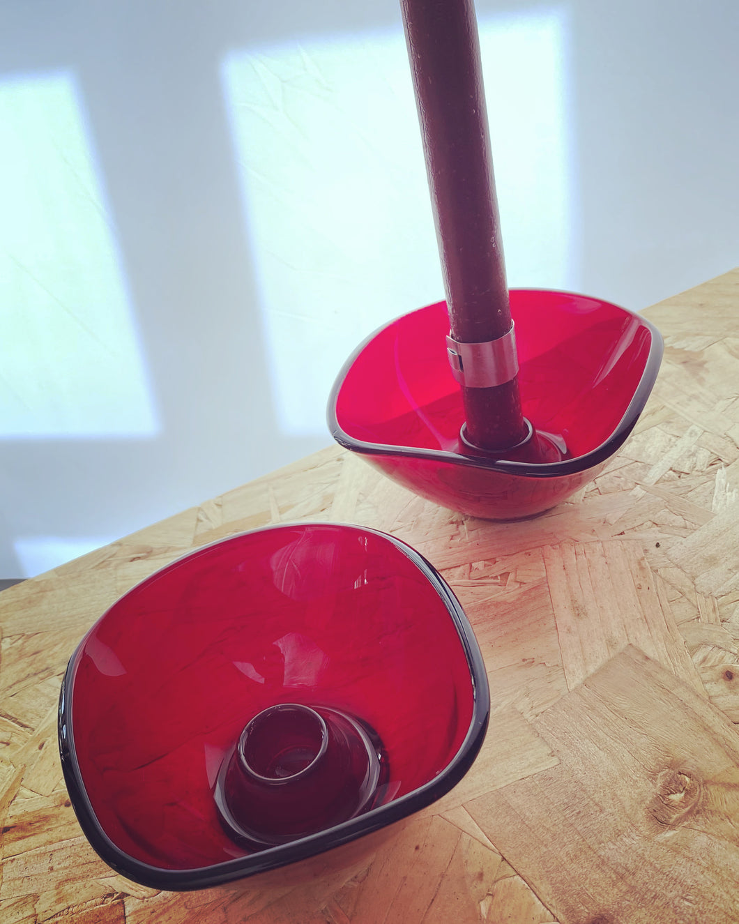 Organic shape candleholders in red, with pattern to base.