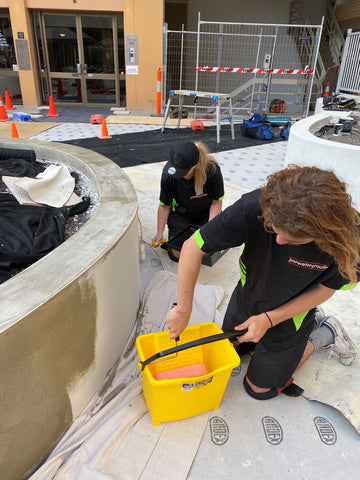 Rohan and Bel from JMRWATERPROOFING applying ARDEX WPM310 to external planter box walls.