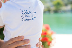 Our Onesies are 100% cotton and soft. Featuring Catch The Cuteness on the back! Catch your little one wearing our favorite onesies.