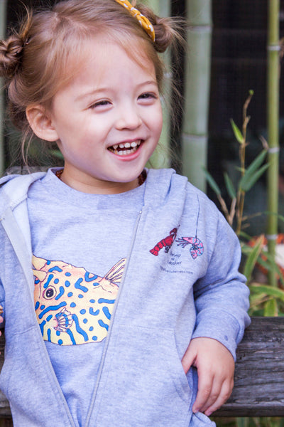 The Cowfish toddler tee is perfect to layer with our Shrimp 'n Lobster hoodies. The zip up front keeps little explorers warm. Show off your love for the ocean when you double up on a Cowfish tee and hoodie! Mix and match your favorite sea creatures!