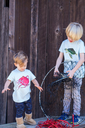 Let your young ocean explorers express themselves by wearing their favorite sea creature. Show that you care for the ocean by wearing an Octopus T-shirt!