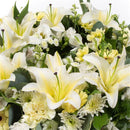 Lemon & White Reflection Wreath. Lilies and alstromeria combine with delicate solidaster. Get fresh flowers from Flowers.IE. Same day flower delivery available.