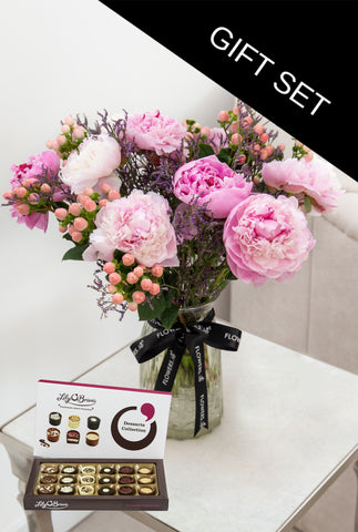 Peonies in Vase with a box of Lily O'Brien Chocolate Desserts Collection